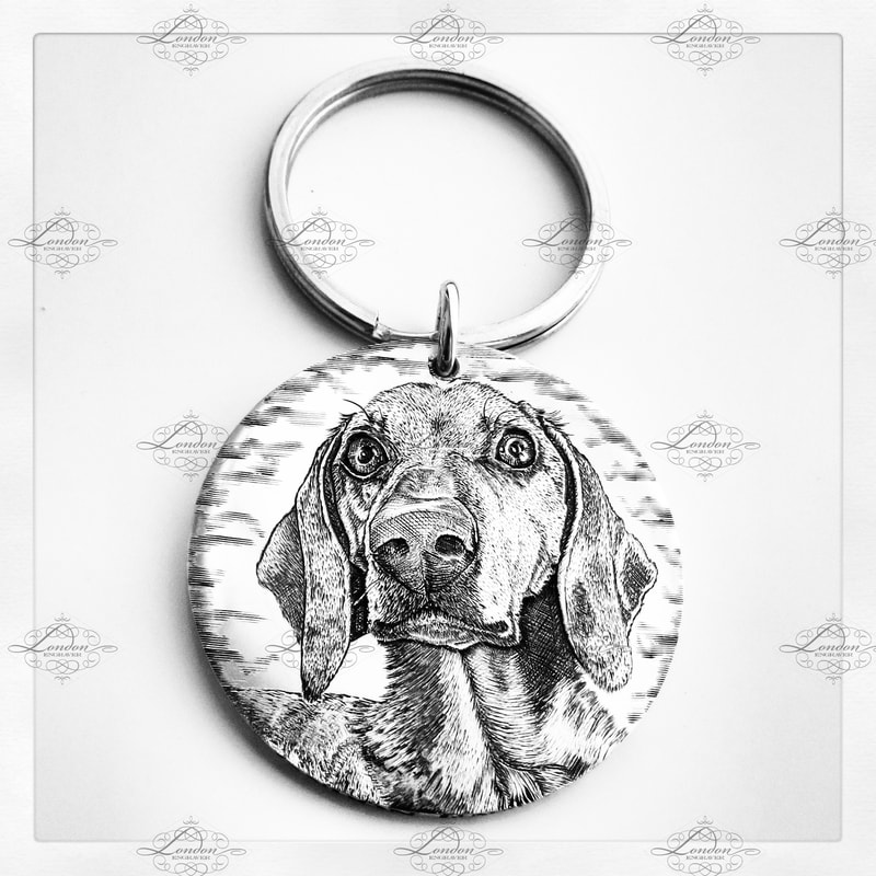Dachshund pet portrait on a sterling silver handmade keyring 32mm wide. Sausage dog, doxie