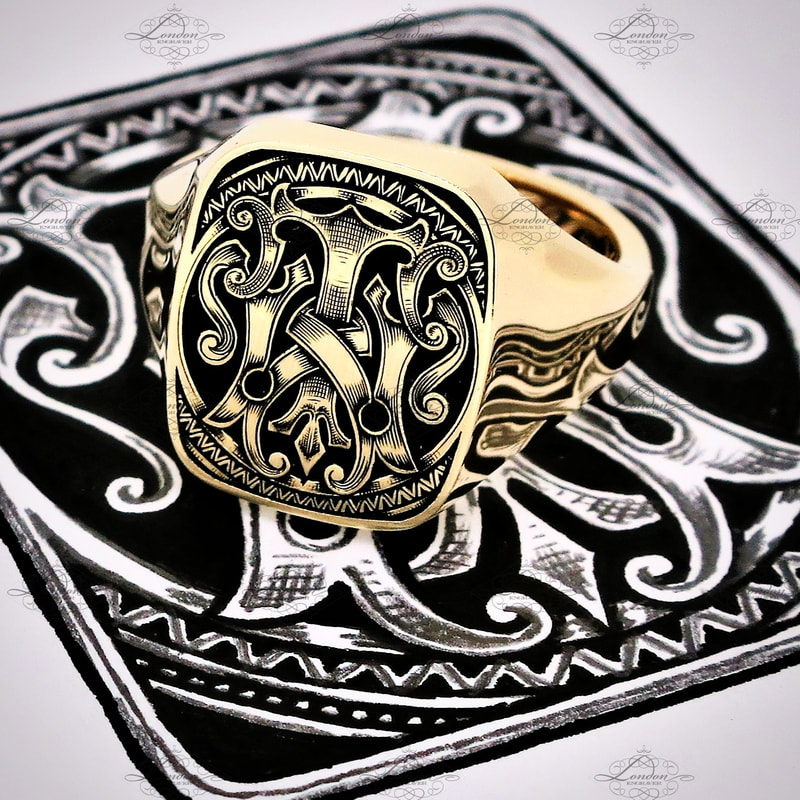 Yellow gold cushion shape signet ring hand engraved with a custom designed TW or WT monogram, with black enamel
