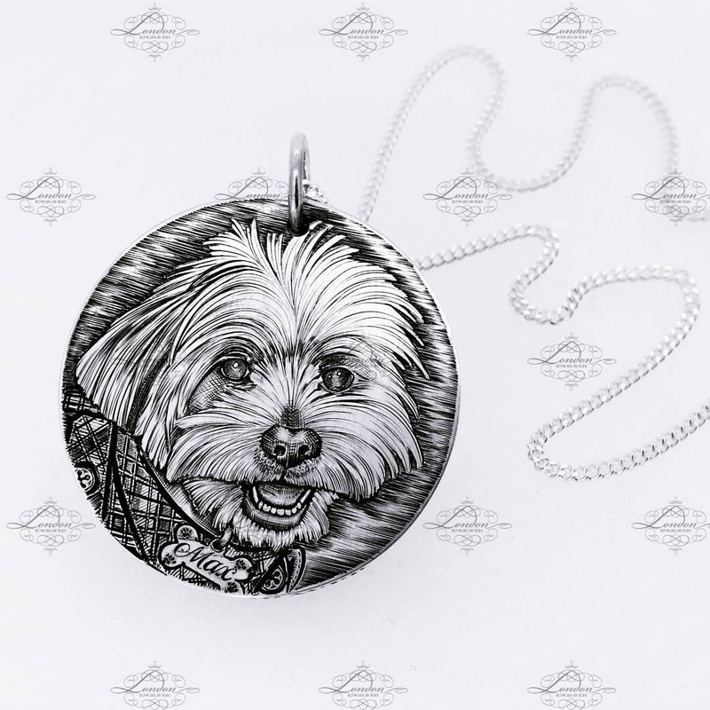 Hand engraved pet portrait on a handmade sterling silver pendant 32mm wide, with silver necklace.