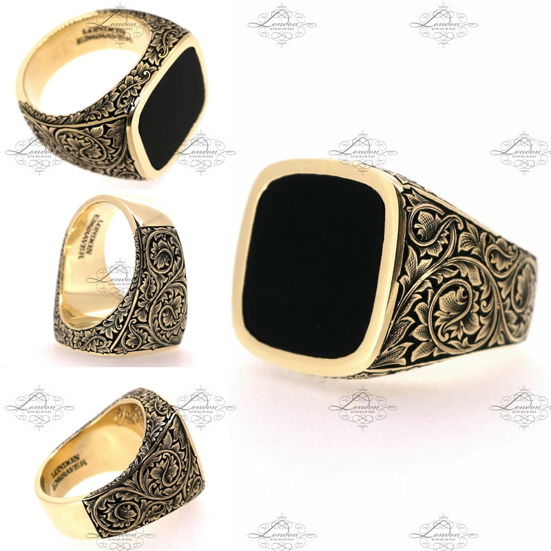 Yellow gold cushion signet ring set with onyx.  Hand engraved leafy scroll patternwork on shoulders