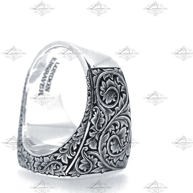 Large cushion signet ring with hand engraved leaf scrollwork on the shoulders, with black enamel