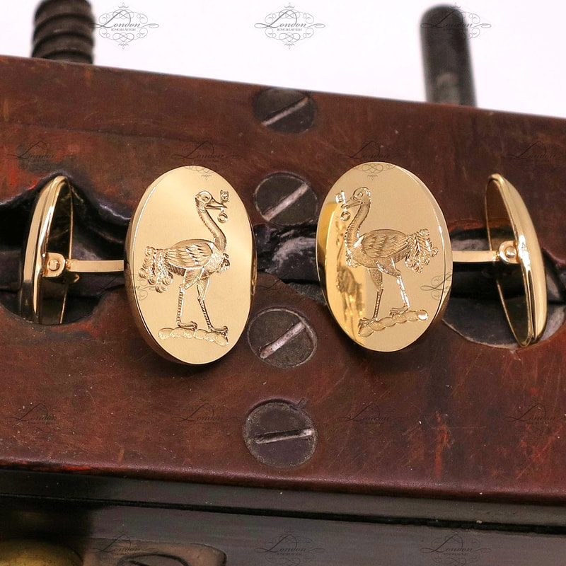 T-bar yellow gold cufflinks hand engraved with a surface engraved family crest - emu holding a key