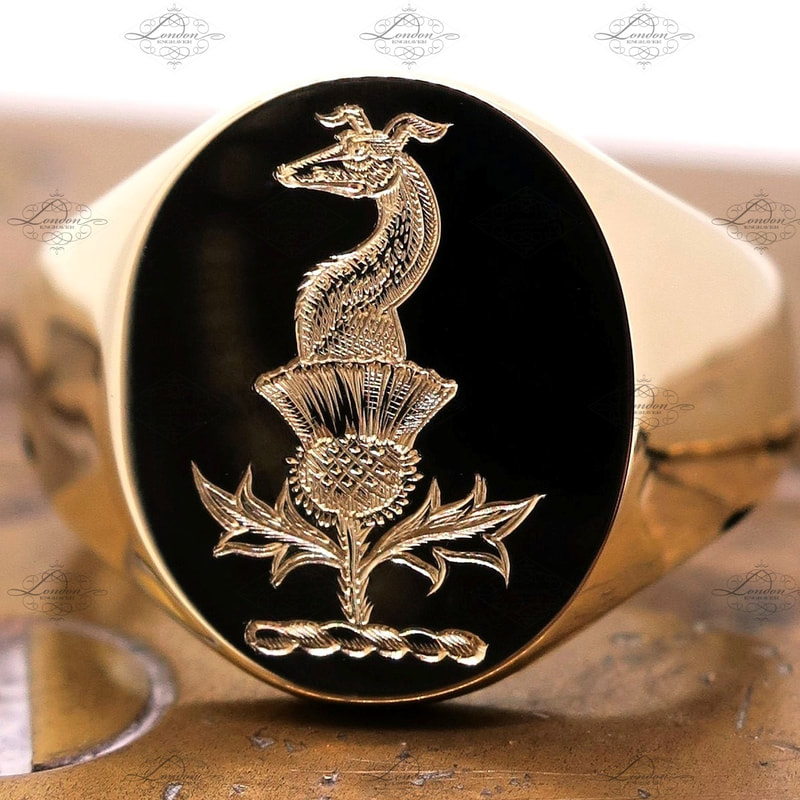 Greyhound and thistle family crest, surface engraved on a yellow gold signet ring