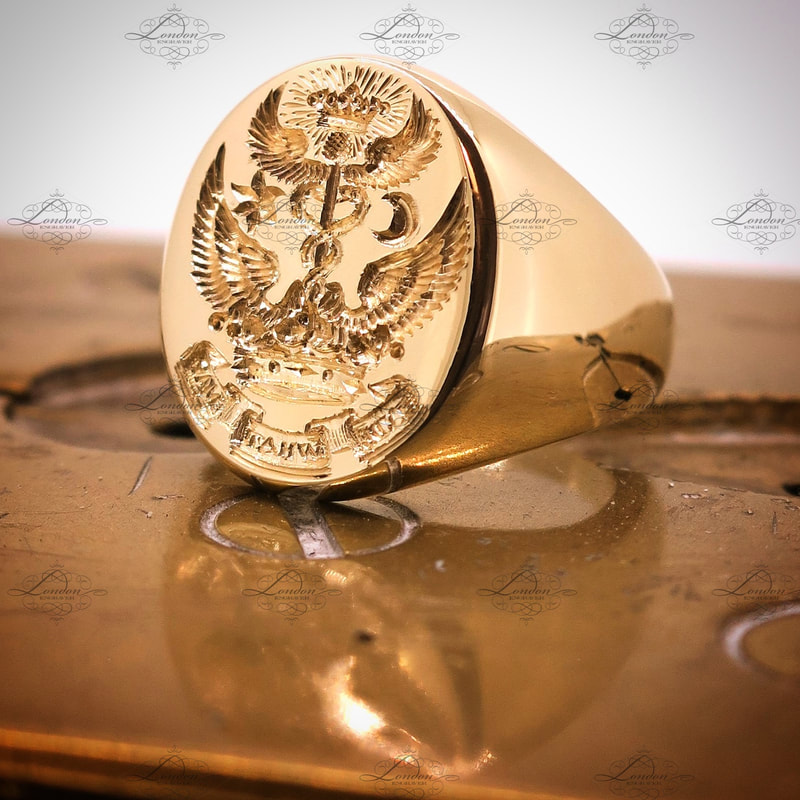 Seal engraved custom design on a yellow gold oxford oval signet ring