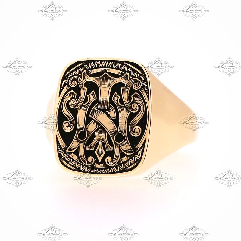 TW or WT monogram on an 18x15 cushion yellow gold signet ring