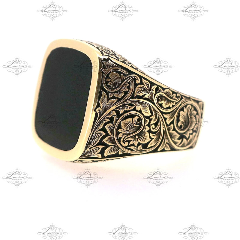 9ct yellow gold cushion signet ring set with onyx. Hand engraved leaf scroll patternwork on the shoulders