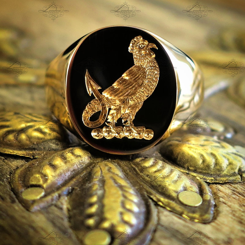 22ct yellow gold signet ring with a seal engraved family crest