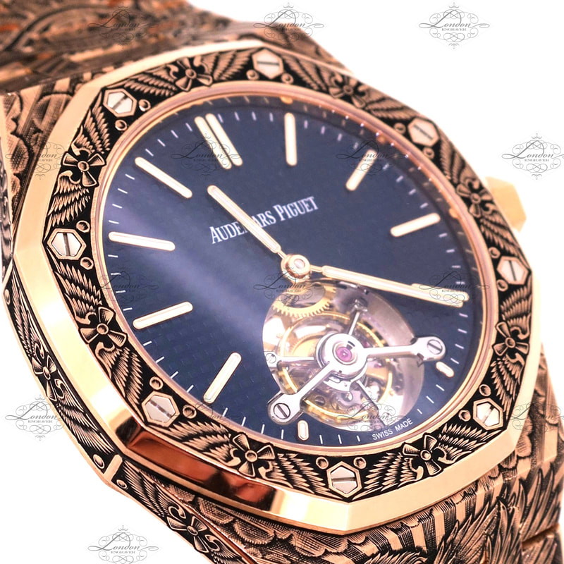 18ct rose gold Audemars Piguet watch face hand engraved with a flight theme - wings and propellers. Tourbillion movement