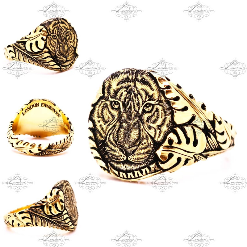 Yellow gold signet ring hand engraved with a tigers face emerging from carved jungle leaves
